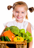 Little girl with the vegetables Royalty Free Stock Photos