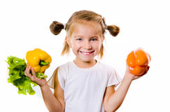 Little girl with the vegetables Stock Image