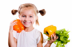 Little girl with the vegetables Royalty Free Stock Image