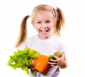 Little girl with the vegetables Stock Photos