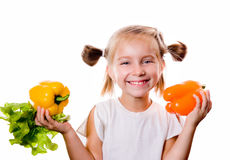 Little girl with the vegetables Royalty Free Stock Images