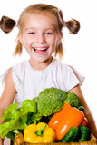 Little girl with the vegetables Stock Images