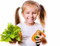 Little girl with the vegetables Royalty Free Stock Photography