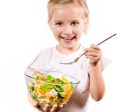 Little girl with the vegetables Stock Photography