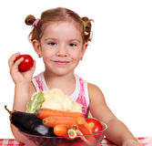 Little girl with vegetables Stock Photography