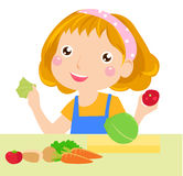 A little girl and vegetables Stock Image
