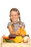 Little girl with vegetables on white Stock Images