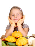 Little girl with vegetables on white Stock Photo