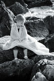 Little girl with a veil by the sea Stock Photography