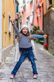 Little girl in Vernazza village in Cinque Terre Stock Photo