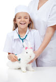 Little girl at the veterinary with her rabbit Stock Photo