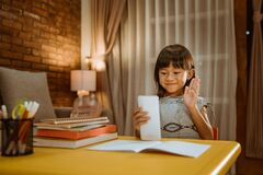 Free Little Girl Video Conference With Her School Mate And Teacher Stock Images - 182817484