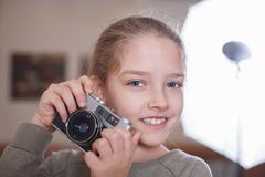 Little girl with a vintage camera. Studio shot royalty free stock photography
