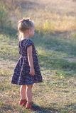 Little girl in vintage dress outdoors Stock Photo