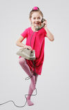 Little girl with vintage phone Stock Photo