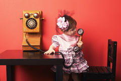 Little girl with vintage phone. Cute little girl with vintage phone stock images