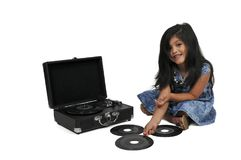 Little girl with vinyl 45 record and player Royalty Free Stock Photo