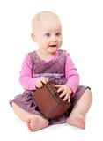 Little girl in violet dress sits and holds chest Stock Image