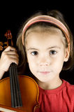 Little girl with violin Stock Images