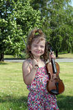 Little girl with violin in park Royalty Free Stock Photography
