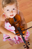 Little girl with a violin - top view Stock Image