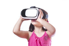 Little girl with virtual reality glasses Stock Image