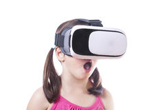 Little girl with virtual reality glasses Stock Photos