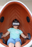 Little girl with virtual reality headset Stock Photo