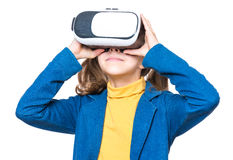 Little girl in VR glasses Stock Photo