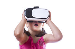 Little girl with VR goggles Stock Photo
