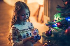 Little girl waiting for Christmas Stock Photos