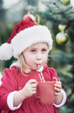 Little girl waiting for a Christmas in the wood. Christmas in juli. Stock Images