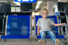 Little girl waiting for flight. Royalty Free Stock Images