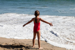 Free Little Girl Waiting For The Ocean Wave Stock Image - 23405041