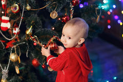 Little girl waiting for a miracle in Christmas decorations Royalty Free Stock Photos