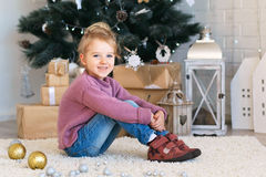 Little girl waiting for a miracle in Christmas decorations Royalty Free Stock Images