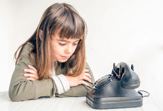 Little girl waiting for the phone to ring Royalty Free Stock Photography