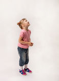 Little girl waiting something and looking up. White background Royalty Free Stock Photos