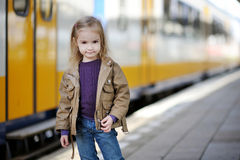 Little girl waiting for train on railway station Royalty Free Stock Image