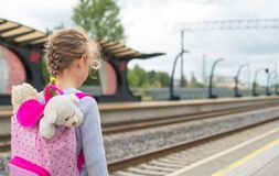 Little girl waiting for train. Royalty Free Stock Photography