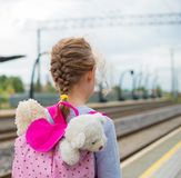 Little girl waiting for train. Stock Photo
