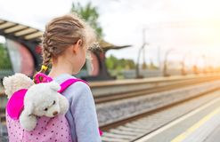 Little girl waiting for train. Stock Images