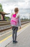 Little girl waiting for train. Stock Image