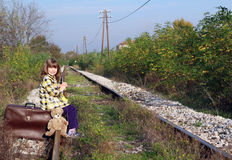Little girl waiting for train Stock Images