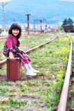 Little girl waiting for the train Royalty Free Stock Photos
