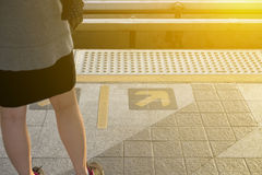 Little girl waiting the train on the train station. Subway metro Stock Images