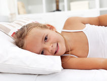 Little girl waking up Stock Photos
