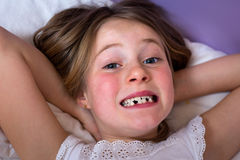 Little girl waking up Stock Images