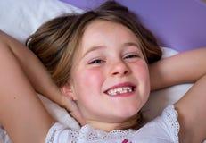 Little girl waking up Stock Image
