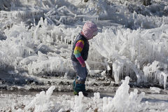Little girl on a walk amongst the ice Stock Image